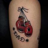 Тату боксерські рукавички: значення
